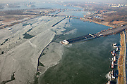 Nederland, Noord-Holland, Amsterdam, 10-01-2009; IJsgang op het Buiten-IJ, ijsschotsen en ijsvelden rond de ingang Zeeburgertunnel; op het tweede plan de Schellingwouderbrug met daar achter de Oranjesluizen en het IJ; ice-floe and ice-fields around the entrance Zeeburgertunnel, northern part Amsterdam; on the second plan with Schellingwouderbrug behind the Orange Sluices and IJ;.ijsschots, ijsveld, veld, schots, schotsen, ijsgang, ijs, natuurijs, winter, koud, vriezen, min nul, beneden nul, koud, celsius, ice, snow, cold, freezing, minus zero, below zero, cold, winterlandschap, winter landscape. .luchtfoto (toeslag); aerial photo (additional fee required); .foto Siebe Swart / photo Siebe Swart