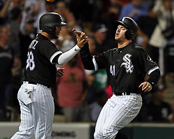 June 28, 2017 - Chicago, IL, USA - The Chicago White Sox's Omar Narvaez (38) and Adam Engel (41) after they both scored on a single by Melky Cabrera against the New York Yankees in the fifth inning at Guaranteed Rate Field in Chicago on Wednesday, June 28, 2017. (Credit Image: © Nuccio Dinuzzo/TNS via ZUMA Wire)