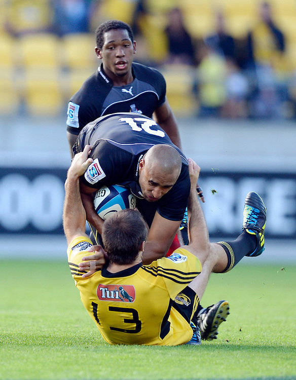 Southern Kings Waylon Murray goes over the top of Hurricanes Conrad Smith in the Super Rugby match at Westpac Stadium, Wellington, New Zealand, Saturday, March 30, 2013. Credit:SNPA / Ross Setford