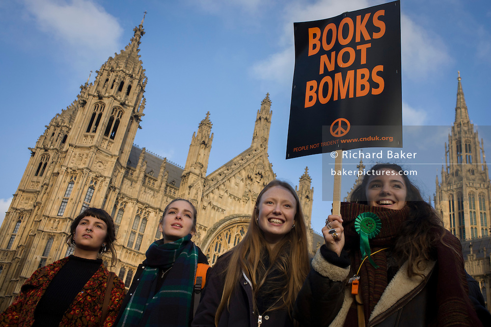 A young student protests outside parliament in Westminster, against spending cuts, tuition fees and student debt.