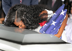 October 21, 2017 - Ft. Lauderdale, Florida, U.S. - MYESHIA JOHNSON the wife of Army Sgt. La David Johnson kisses her husband's casket at Hollywood Memorial Gardens. Johnson was working with U.S. Army Special Forces in Northwestern Africa when Islamic militants ambushed them on Oct. 4, near the Niger border. (Credit Image: © Mike Stocker/Sun-Sentinel via ZUMA Wire)