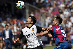 September 16, 2017 - Valencia, Spain - 18 Carlos Soler of Valencia CF (L) in action against 03 Antonio Garcia Aranda, Tono, of Levante Ud  (R) during spanish La Liga Santander match between Levante UD and Valencia CF  at Ciutat de Valencia  Stadium on  September  16, 2017. (Credit Image: © Jose Miguel Fernandez/NurPhoto via ZUMA Press)