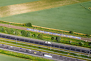 Nederland, Zuid-Holland, Dordrecht, 10-06-2015; Polder De zuidpunt, ten noorden van Moerdijkbruggen. Infrastructuurbundel: spoorlijn Dordrecht - Breda met Sprinter loop parallel aan autoweg A16.<br /> Infrastructure, parallel railway and motorway Dordrecht - Breda.<br /> luchtfoto (toeslag op standard tarieven);<br /> aerial photo (additional fee required);<br /> copyright foto/photo Siebe Swart