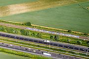 Nederland, Zuid-Holland, Dordrecht, 10-06-2015; Polder De zuidpunt, ten noorden van Moerdijkbruggen. Infrastructuurbundel: spoorlijn Dordrecht - Breda met Sprinter loop parallel aan autoweg A16.<br /> Infrastructure, parallel railway and motorway Dordrecht - Breda.<br /> luchtfoto (toeslag op standard tarieven);<br /> aerial photo (additional fee required);<br /> copyright foto/photo Siebe Swart