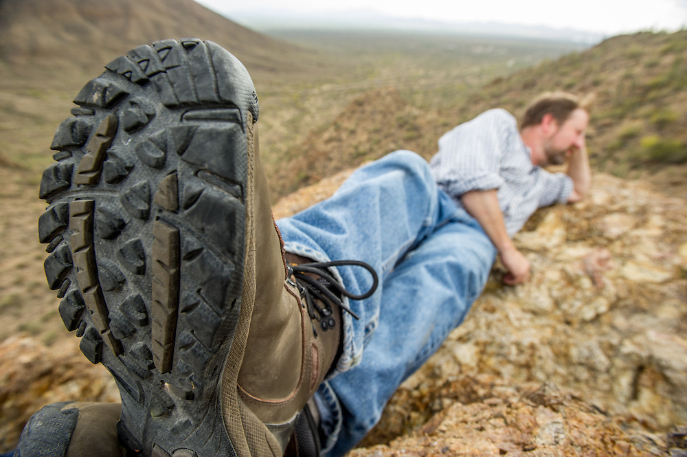 Hiker resting in desert, Tucson AZ