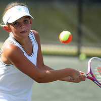 Colbie O'Rear keeps a eye on the ball during tennis practice Thursday afternoon at the Tupelo Country Club. The team has advanced to the USTA Southern Sectionals.