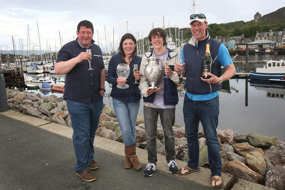 The Silvers Marine Scottish Series 2014, organised by the  Clyde Cruising Club,  celebrates it's 40th anniversary.<br /> <br /> Overal winners Red Hot Poker crew with Murray Caldwell.<br /> <br /> Credit : Marc Turner / PFM