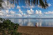 A Woman Walking Along the Anini Shore in Kauai Hawaii