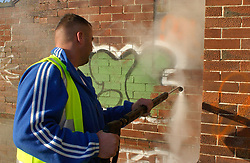 Graffiti being removed from estate in North Tyneside by local authority staff. UK
