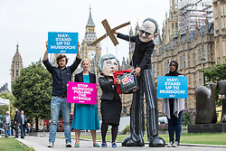 © Licensed to London News Pictures. FILE PICTURE: 29/06/2017. London, UK. Campaigners, including ANTONIA STAATS (second left) from Avaaz at a photocall outside Parliament with Rupert Murdoch controlling a puppet Prime Minister Theresa May. Antonia Staats has reportedly been in a relationship with Government scientist Neil Ferguson, which involved the breaking of lockdown rules. Photo credit: Rob Pinney/LNP