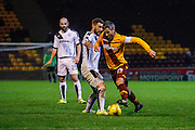 Motherwell FC Midfielder Keith Lasley takes on the Dundee defence during the Ladbrokes Scottish Premiership match between Motherwell and Dundee at Fir Park, Motherwell, Scotland on 12 December 2015. Photo by Craig McAllister.