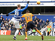 Queens Park Rangers forward Sebastian Polter looks to volley but Wolverhampton Wanderers defender Ethan Ebanks-Landell heads the ball clear during the Sky Bet Championship match between Queens Park Rangers and Wolverhampton Wanderers at the Loftus Road Stadium, London, England on 23 January 2016. Photo by Andy Walter.