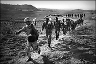 Eritrean soldiers marching off to war during their bloody 2-year border war with Ethiopia in which tens of thousands of people died and millions made homeless on both sides..