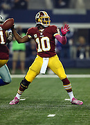 Washington Redskins quarterback Robert Griffin III (10) throws a first quarter pass during the NFL week 6 football game against the Dallas Cowboys on Sunday, Oct. 13, 2013 in Arlington, Texas. The Cowboys won the game 31-16. ©Paul Anthony Spinelli