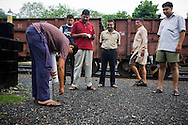 A parked train carrying iron ore is seen in the background as passengers of the Himsagar Express 6318 get down for morning chai and fresh air as the train halts near Dharakhoa between the stations of Itarsi Junction and Nagpur on 8th July 2009.. .6318 / Himsagar Express, India's longest single train journey, spanning 3720 kms, going from the mountains (Hima) to the seas (Sagar), from Jammu and Kashmir state of the Indian Himalayas to Kanyakumari, which is the southern most tip of India...Photo by Suzanne Lee / for The National