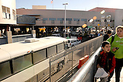 A bus transporting deportees from the USA, to Nogales, Sonora, Mexico, approaches the Dennis DeConcinni Port of Entry customs inspection station in Nogales, Arizona, USA.  Deportees transported by bus to the border are typically those who were found to have entered the USA illegally.