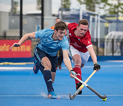 Reading's James Carson is tackled by Bill Cain of Canterbury. Canterbury v Reading - Men's Cup Final, Lee Valley Hockey & Tennis Centre, London, UK on 29 April 2017. Photo: Simon Parker