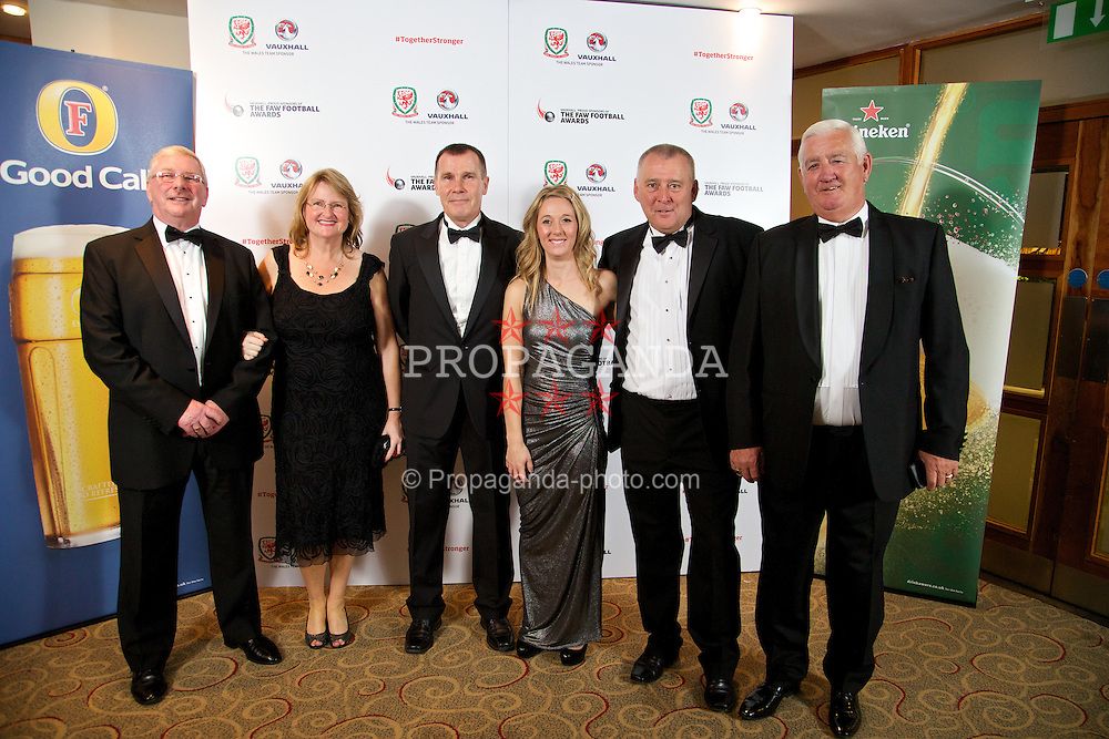 CARDIFF, WALES - Monday, October 6, 2014: Wales' Dai Griffiths, Jan Hoskin, women's teams manager Jarmo Matikainen, Tricia Ann Turner, Steve Williams and Phil Pritchard at the FAW Footballer of the Year Awards 2014 held at the St. David's Hotel. (Pic by David Rawcliffe/Propaganda)