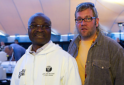 Slovenian journalist of Radio Slovenija Bostjan Janezic (R) and Roger Milla, world star of African football from Cameroon when he presents his foundation created in 2005 for children in need, on June 26, 2010 at Nelson Mandela Square, Sandton, suburb of Johannesburg, South Africa. (Photo by Vid Ponikvar / Sportida)