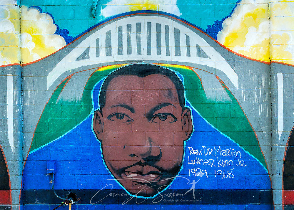 "A mural featuring Dr. Martin Luther King Jr. is painted on a building at Civil Rights Memorial Park, Feb. 7, 2015, in Selma, Alabama. The park was established in 2001 and includes murals and plaques honoring those who led the Civil Rights movement in Selma in the 1960's. The mural was part of the ""Liberation Summer Project"" in 1999. (Photo by Carmen K. Sisson/Cloudybright)"