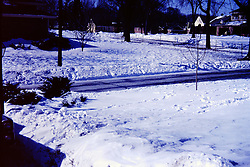 Photos taken by George Look.  Image started as a color slide.  Converted to black and white via computer software.  Dust and other artifacts may exist.<br /> <br /> <br /> Snow fall of 1967.  S. Eighth Street, Pekin Illinois