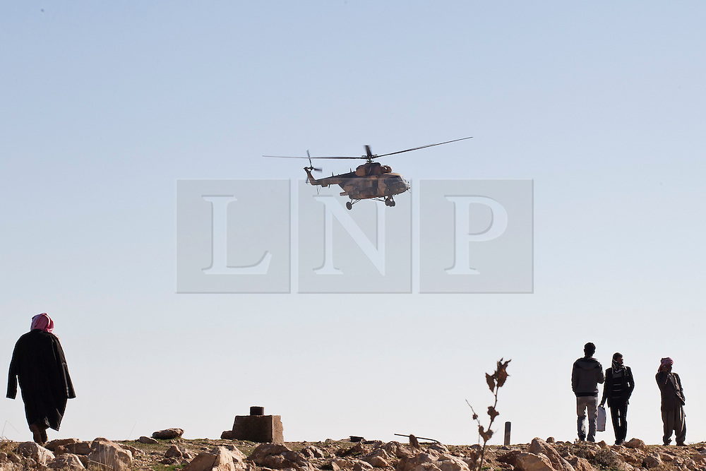 &copy; Licensed to London News Pictures. 11/12/2014. Sinjar Mountains, Iraq. An Iraqi Air Force Mi-17 Hip helicopter comes in for a supply run on the top of Mount Sinjar.<br /> <br /> Although a well publicised exodus of Yazidi refugees took place from Mount Sinjar in August 2014 many still remain on top of the 75 km long ridge-line, with estimates varying from 2000-8000 people, after a corridor kept open by Syrian-Kurdish YPG fighters collapsed during an Islamic State offensive. The mountain is now surrounded on all sides with winter closing in, the only chance of escape or supply being by Iraqi Air Force helicopters. Photo credit: Matt Cetti-Roberts/LNP