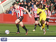 Danny Wright and Moses Emmanuel during the Vanarama National League match between Cheltenham Town and Bromley at Whaddon Road, Cheltenham, England on 30 January 2016. Photo by Antony Thompson.