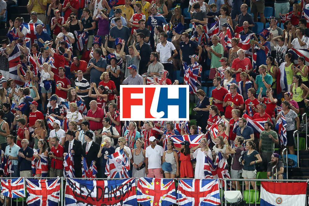 RIO DE JANEIRO, BRAZIL - AUGUST 17: The Great Britain crowd celebrate during the womens semifinal match between the Great Britain and New Zealand on Day 12 of the Rio 2016 Olympic Games at the Olympic Hockey Centre on August 17, 2016 in Rio de Janeiro, Brazil.  (Photo by Mark Kolbe/Getty Images)