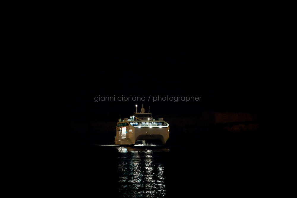 25 February 2011. Valletta, Malta. The Maria Dolores ferry arrives in the harbor of Valletta, Malta. A U.S.-chartered ferry evacuated Americans and other foreigners out of Libya on Friday and brought them to the Mediterranean island of Malta. The Maria Dolores ferry, after three days of delays, brought over 300 passengers, including at 167 U.S. citizens, away from Libya where Colonel Gaddafi's forces continue to clash with anti-government demonstrators.<br /> <br /> <br /> &copy;2011 Gianni Cipriano<br /> cell. +1 646 465 2168 (USA)<br /> cell. +39 328 567 7923<br /> gianni@giannicipriano.com<br /> www.giannicipriano.com