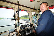 {8/24/12} {10pmCST} -JOB # 42286- Greenville , MS, U.S.A. -- Sandbars creep up as the water level drops on the Mississippi River makeing navigating the Mississippi River difficult for tug boat captain Ron Mook, Friday August 24,2012. Historically low river levels on the Mississippi River are causing havoc on river traffic: grounding barges loaded with grain and fertilizer, traffic jams several miles long and forcing the Coast Guard to close down chunks of the river due to groundings. The area around Greenville, Miss., has closed three times the past week due to groundings. Last year, there were five total groundings the entire low-water season. Locals who fought historic high-water floods last year are this year engaged in a different fight: keeping barges afloat on a vanishing Mississippi.  -- Photo by Suzi Altman, Freelance.