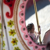 100214      Cayla Nimmo<br /> <br /> Evianna Mills rides the marry-go-round during children's day Thursday afternoon at the Northern Navajo Nation Fair in Shiprock.