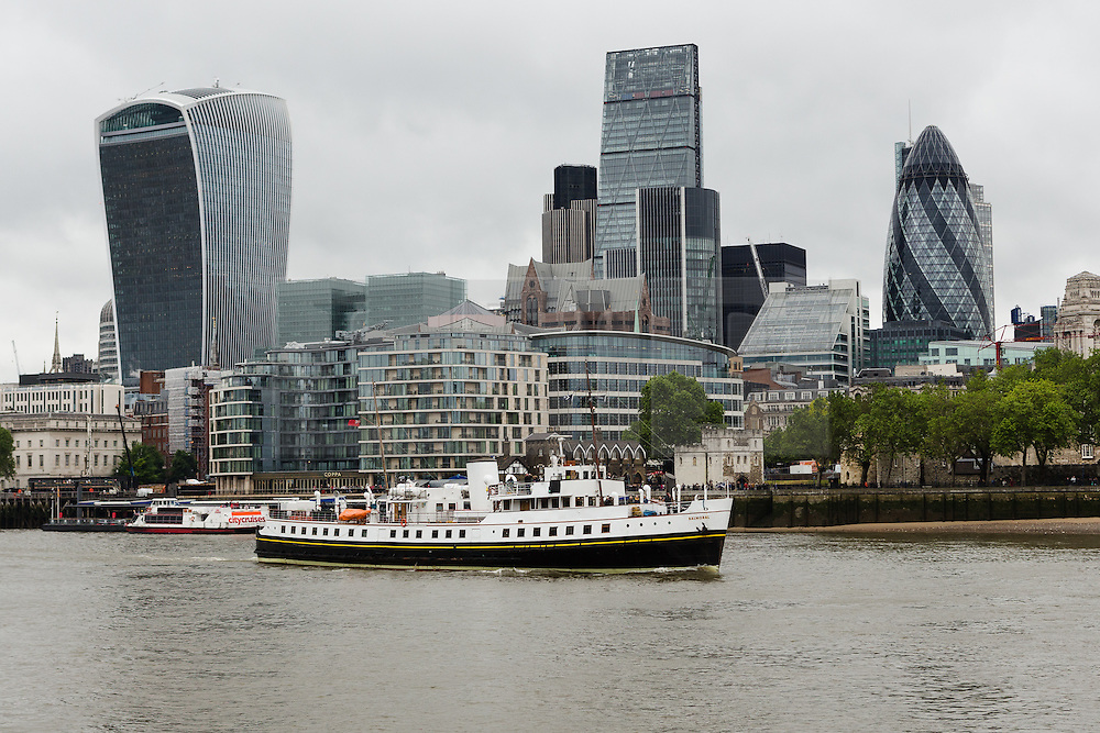 © Licensed to London News Pictures. 31/05/2016. LONDON, UK.  MV Balmoral arrives in central London passing the Gerkin, Walkie Talkie and Cheesgrater skyscrapers during rainy, windy weather today. Popular heritage excursion ship MV Balmoral has returned to the Thames for the first time since 2012. The ship, listed on the National Historic Fleet register, was laid up in 2013 and her future looked uncertain but a Bristol-based charity was formed to preserve the vessel and return to her use. She will be undetaking journeys up and down the Thames and around the coast throughout June.  Photo credit: Vickie Flores/LNP