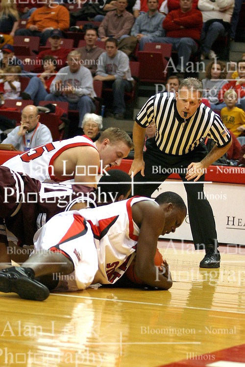 18 January 2004 Marcus Arnold skirmishes for a ball under the watchful eye of referee Gerry Pollard. Illinois State University Redbirds host the Southwest Missouri State Bears at Redbird Arena in Normal IL
