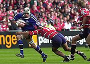 Sport - Rugby 28/04/2002 Parker Pen Shield - Semi-Final.Gloucester vs Sale - Franklin Gardens - Northampton. Shark's flanker, Chris Jones breaks through Terry Fanolue tackle..[Mandatory Credit, Peter Spurier/ Intersport Images].