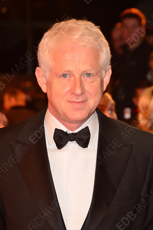 08.JANUARY.2012. LONDON<br /> <br /> RICHARD CURTIS ARRIVES AT THE WAR HORSE PREMIERE HELD AT THE ODEON LEICESTER SQUARE IN LONDON.<br /> <br /> BYLINE: EDBIMAGEARCHIVE.COM<br /> <br /> *THIS IMAGE IS STRICTLY FOR UK NEWSPAPERS AND MAGAZINES ONLY*<br /> *FOR WORLD WIDE SALES AND WEB USE PLEASE CONTACT EDBIMAGEARCHIVE - 0208 954 5968*