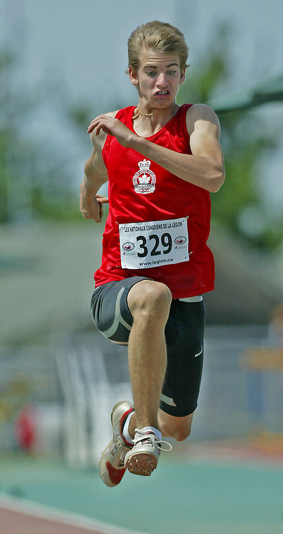 (Sherbrooke, Quebec -- 9 Aug 2009)  Mitch O'Donnell of Ontario competes in boys under-15 triple jump final at the 2009 Royal Canadian Legion National Youth track and field championships. Photograph copyright Sean Burges / Mundo Sport Images  2009.