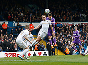 Leeds United defender Matthew Pennington and Bolton Wanderers forward Adam Le Fondre contest an aerial ball  during the EFL Sky Bet Championship match between Leeds United and Bolton Wanderers at Elland Road, Leeds, England on 30 March 2018. Picture by Paul Thompson.