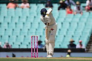 Indian player Cheteshwar Pujara defends the ball at the 4th Cricket Test Match between Australia and India at The Sydney Cricket Ground in Sydney, Australia on 03 January 2019.