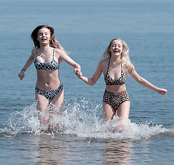Edinburgh was covered in glorious sunshine today as the temperature was predicted to hit 23 degrees<br /> <br /> Pictured: Edinburgh girls Andi Brown (left) and Taylor Reid have fun in the sea at Portobello Beach<br /> <br /> Alex Todd | Edinburgh Elite media