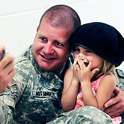 (deploy174th Phillips Carrizo 06/15/09) Ssg. Brian Motsinger takes a picture with his nice Erica, 3, before the deployment ceremony for  28 members of the Ohio Army National Guards' 174th Air Force Defense Artillery Bragade  participating in the Operational Mentor and Liaison Team 9-3 mission on Monday, June 15, 2009 in Groveport, Ohio. They are mobilizing to Afghanistan to aid the training of Afghan National Army forces. (Columbus Dispatch Photo by Leonardo Carrizo)