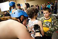 Dahmer Natrix signs autographs for fans during halftime. The San Diego Derby Dolls skated to victory, beating the Mitten Kittens of Michigan 193-58 in their first home bout on their new banked track.