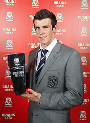 CARDIFF, WALES - Tuesday, October 4, 2011: Wales' Gareth Bale with the Player of the Year award at the FAW Footballer of the Year Awards 2011 held at the Wales National Museum. (Pic by David Rawcliffe/Propaganda)