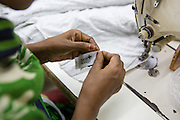 A C&A label being stitched in to a T-shirt inside an Epyllion Group garment factory in Bangladesh.