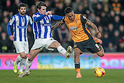 Abel Hernández (Hull City) tries to get a shot off under pressure from the Sheffield Wednesday defender during the Sky Bet Championship match between Hull City and Sheffield Wednesday at the KC Stadium, Kingston upon Hull, England on 26 February 2016. Photo by Mark P Doherty.
