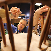 Mandy Jackson learns how to paint furniture during a class at Farmhouse in Tupelo.
