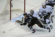 May 26, 2013; San Jose, CA, USA; San Jose Sharks center Joe Pavelski (8) reaches for the puck against the Los Angeles Kings during the first period in game six of the second round of the 2013 Stanley Cup Playoffs at HP Pavilion.