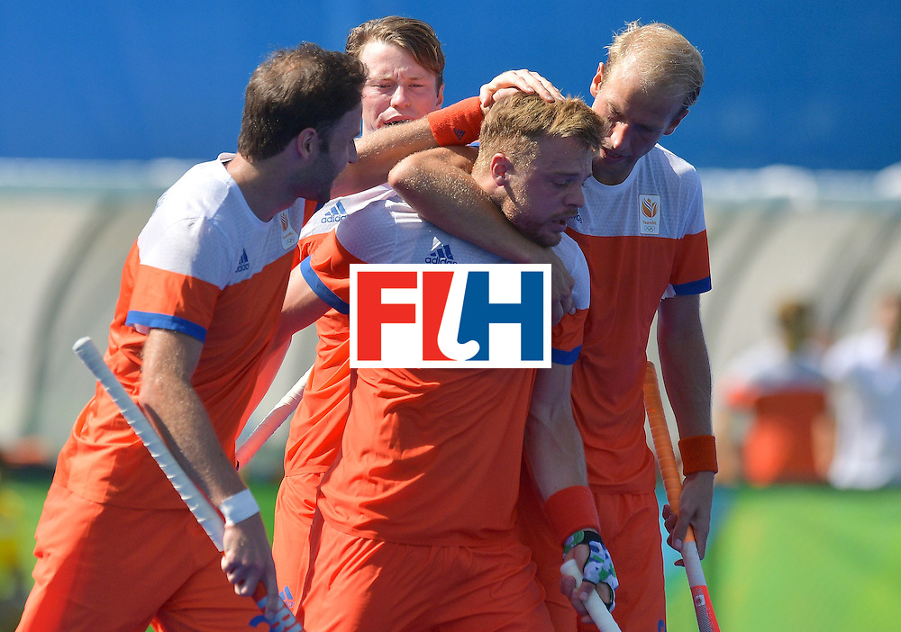 Netherland's Mink van der Weerden (C) celebrates scoring a goal during the men's field hockey Argentina vs Netherlands match in the Rio 2016 Olympics Games on August, 6 2016 at the Olympic Hockey Centre in Rio. / AFP / Carl DE SOUZA        (Photo credit should read CARL DE SOUZA/AFP/Getty Images)