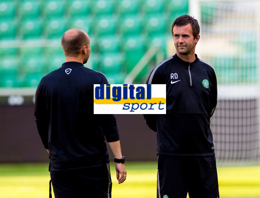 29/07/14<br /> CELTIC TRAINING<br /> PEPSI ARENA - WARSAW<br /> Celtic manager Ronny Deila (right) chats with his new coach Haakon Lunov