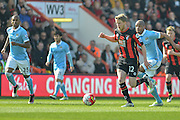 Bournemouth FC midfielder (32) Eunan O'Kane breaking through midfield during the Barclays Premier League match between Bournemouth and Manchester City at the Goldsands Stadium, Bournemouth, England on 2 April 2016. Photo by Mark Davies.