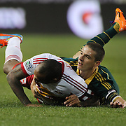 Thierry Henry, (left), New York Red Bulls, is fouled by Will Johnson, Portland Timbers, during the New York Red Bulls Vs Portland Timbers, Major League Soccer regular season match at Red Bull Arena, Harrison, New Jersey. USA. 24th May 2014. Photo Tim Clayton
